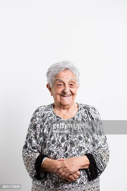 portrait of happy senior woman in front of white background - old lady funny stock pictures, royalty-free photos & images