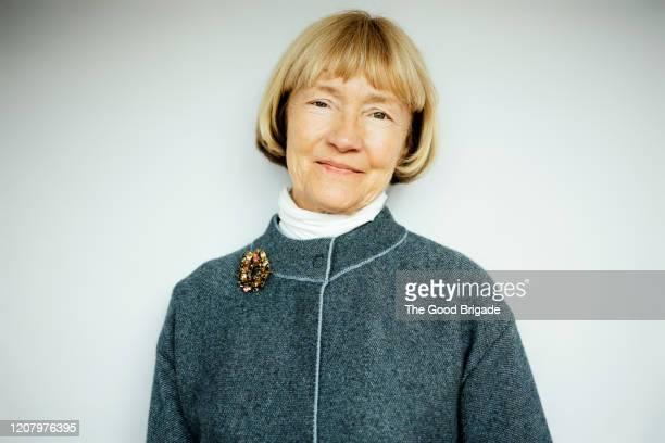 portrait of happy senior woman on white background - brooch - fotografias e filmes do acervo