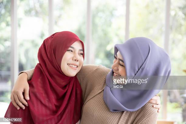 portrait of happy smiling two asian muslim woman - religion stock pictures, royalty-free photos & images