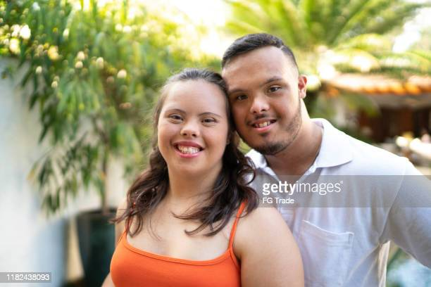 portrait of happy special needs couple looking at camera - intellectually disabled stock pictures, royalty-free photos & images