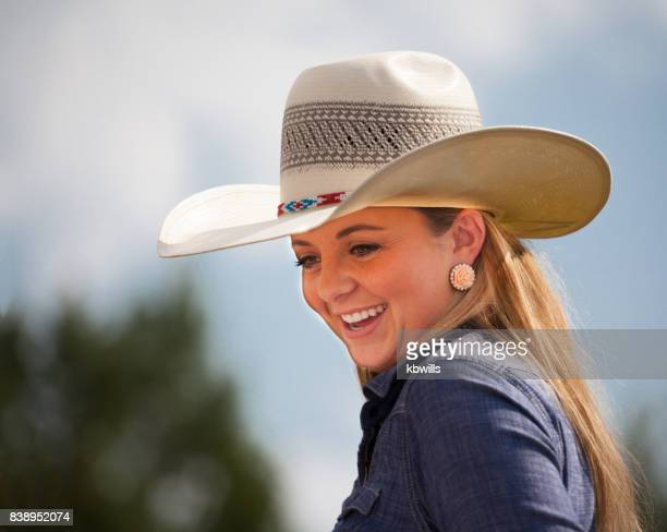 portrait of happy teenage young utah cowgirl with stetson in sun - cowgirl hairstyles stock photos and pictures