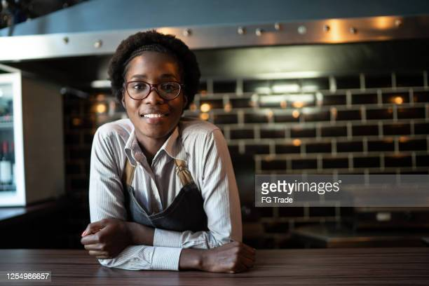 portrait of happy waitress behind the counter - chef stock pictures, royalty-free photos & images
