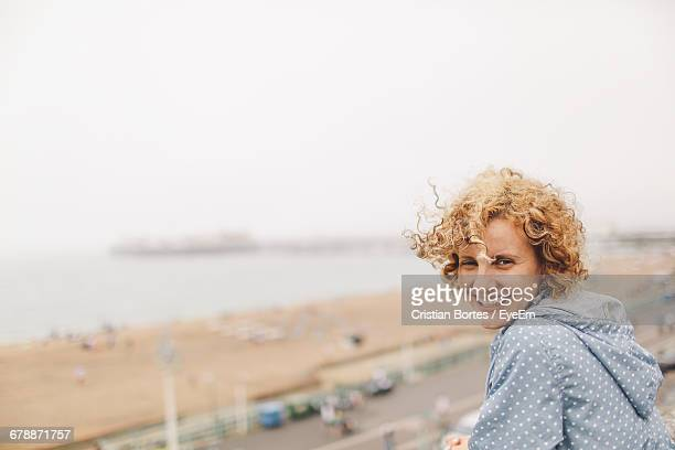 portrait of happy woman against clear sky - bortes stock pictures, royalty-free photos & images