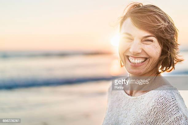 Portrait of happy woman at beach