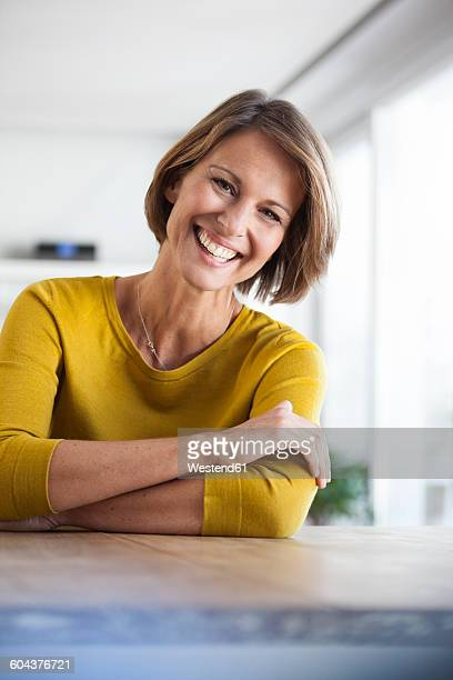Portrait of happy woman at home