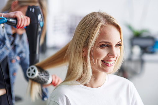 Portrait of happy woman at the hairdresser's - gettyimageskorea