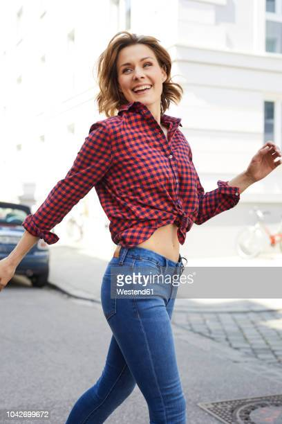 Portrait of happy woman crossing the street
