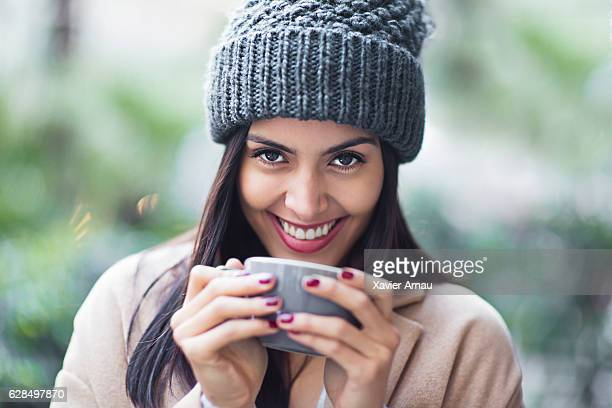 Portrait of happy woman holding coffee cup