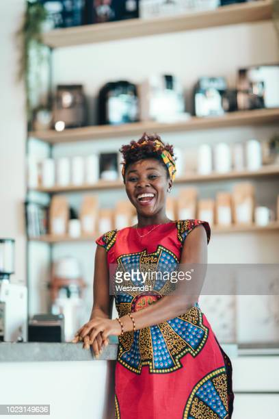 portrait of happy woman in a coffee bar - traditional clothing stock pictures, royalty-free photos & images