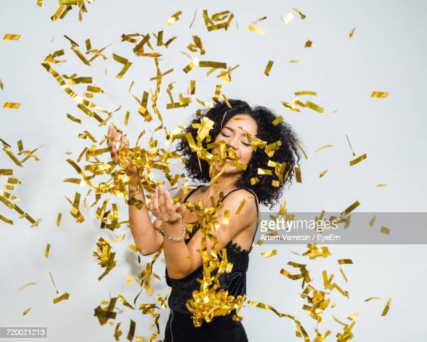Portrait Of Happy Woman In Confetti