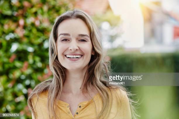 Portrait of happy woman in garden