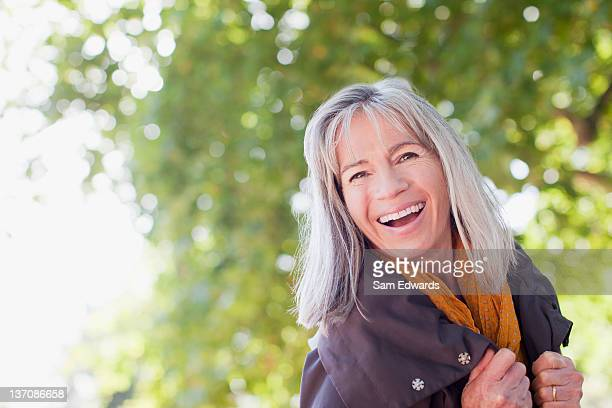 Portrait of happy woman in park