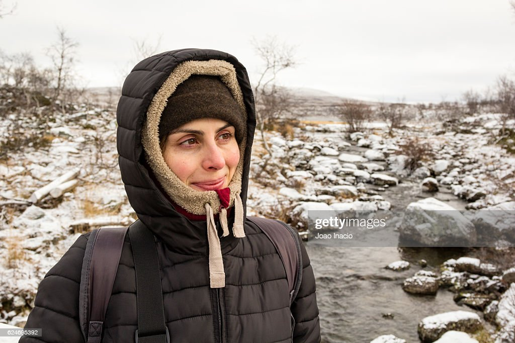 Portrait of happy woman in snowy field : Stock Photo