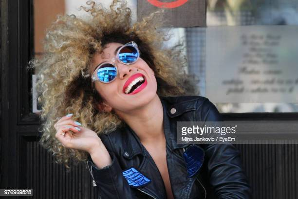 portrait of happy woman in sunglasses - cosmetics stock photos and pictures