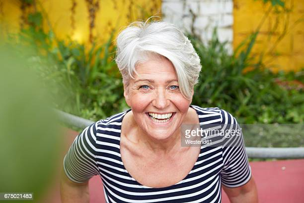 Portrait of happy woman in the garden