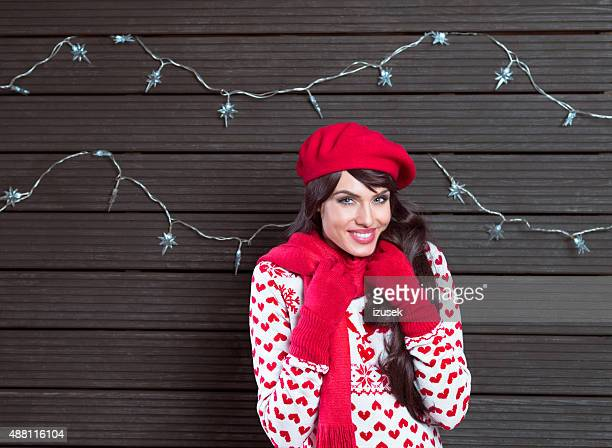 Portrait of happy woman in winter outfit