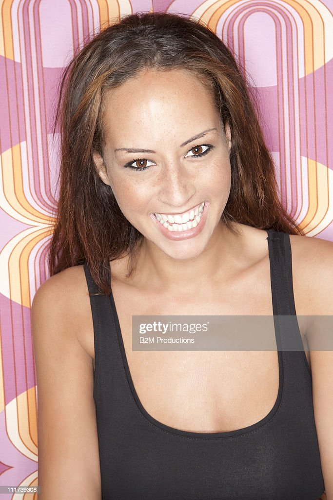 Portrait of happy woman on coloured background : Stock Photo