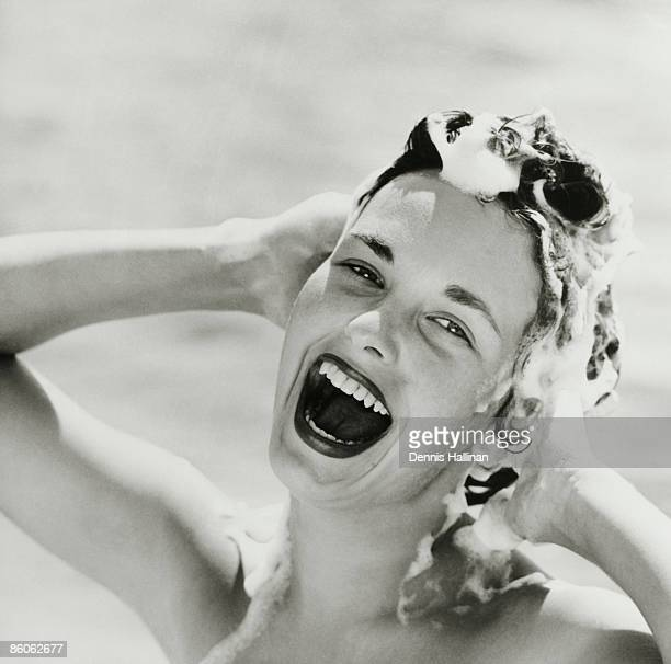 Portrait of Happy Woman Shampooing Hair