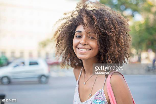 Portrait of happy woman standing in city