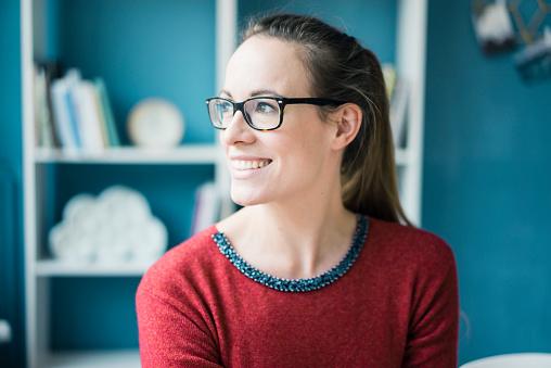 Portrait of happy woman wearing glasses - gettyimageskorea