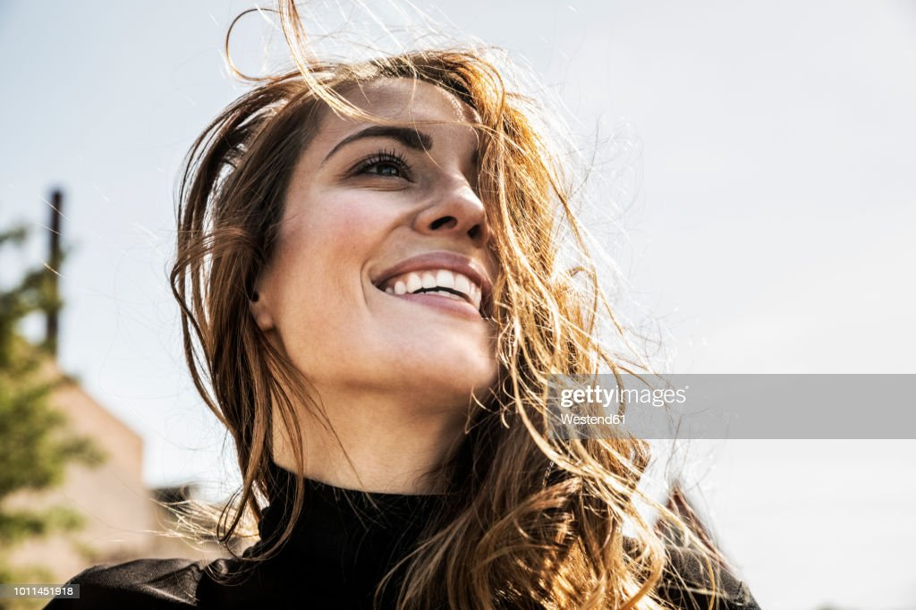 Portrait of happy woman with blowing hair : Stock Photo