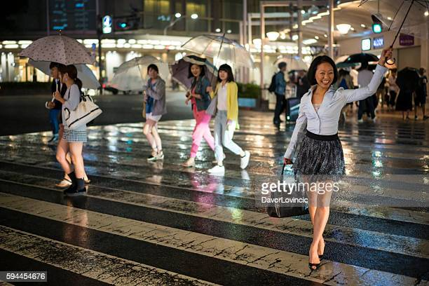 Portrait of  happy woman with umbrella on street in Kyoto.