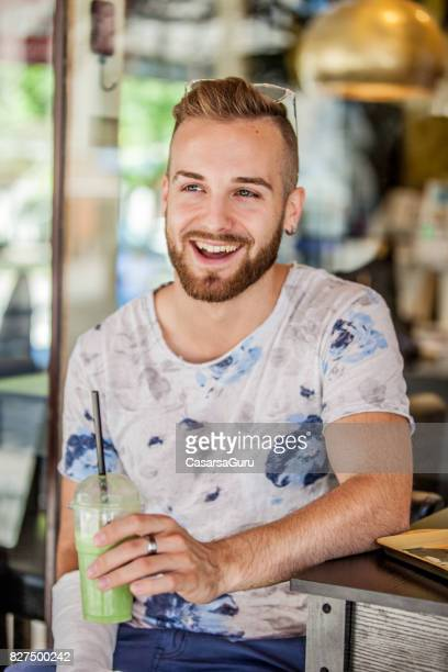 Portrait of Happy Young Adult Man with Broken Arm