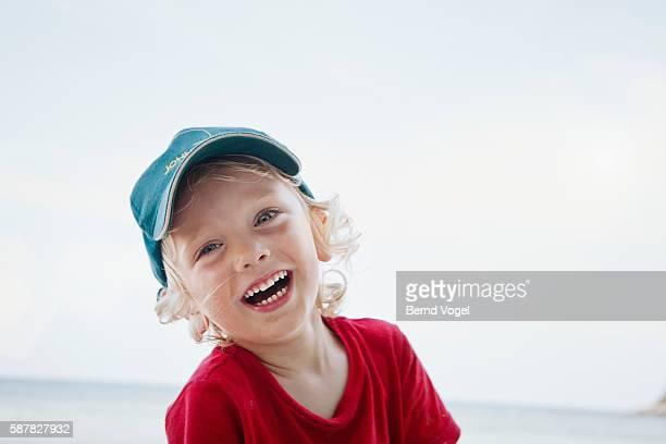 Portrait of happy young boy (7-9)