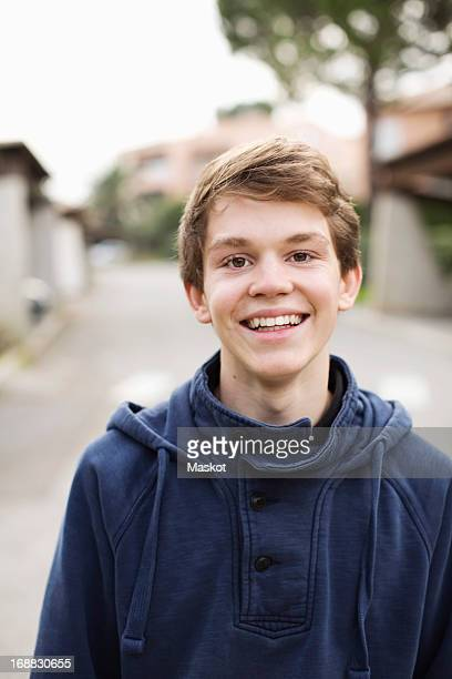 Portrait of happy young boy standing outdoors