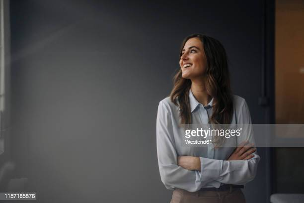 portrait of happy young businesswoman looking sideways - looking away stock pictures, royalty-free photos & images