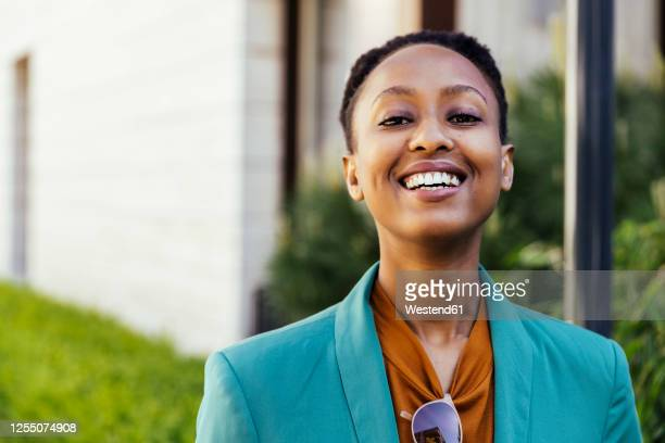 portrait of happy young businesswoman - black blazer stock pictures, royalty-free photos & images