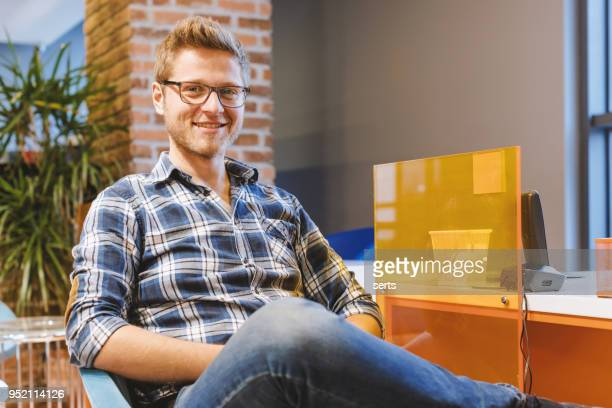 Portrait of happy young costumer man in sales office