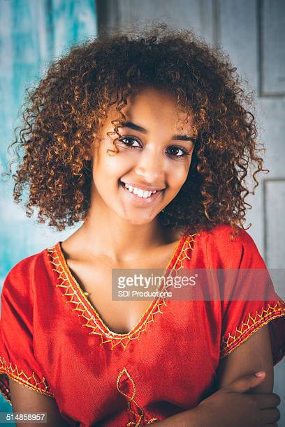 portrait of happy young ethiopian woman in traditional clothing - beautiful ethiopian girls stock photos and pictures