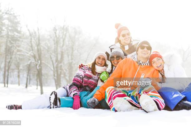 portrait of happy young friends in snow - ski pants stock pictures, royalty-free photos & images