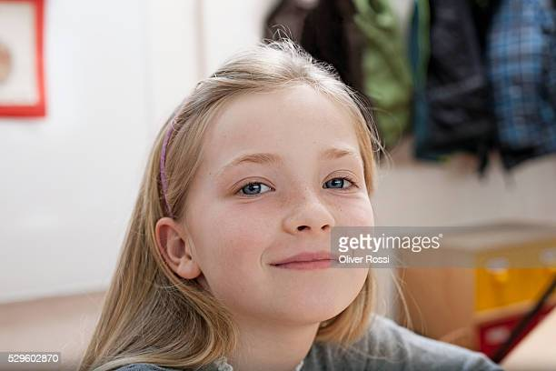 Portrait of happy young girl (8-9)
