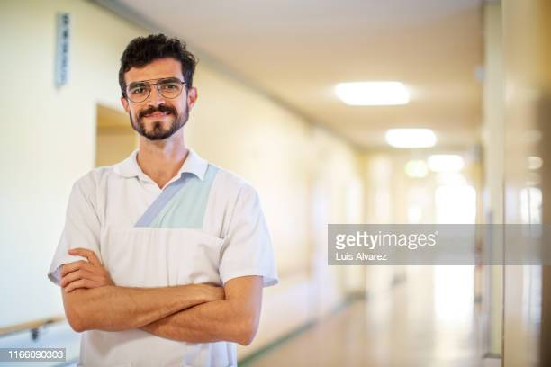 portrait of happy young male healthcare worker - north african ethnicity stock pictures, royalty-free photos & images