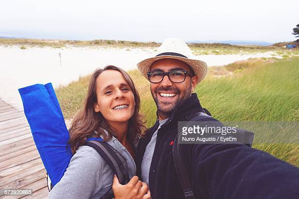 Portrait Of Happy Young Man And Woman At Paradise Beach