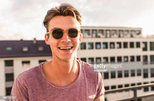 Portrait of happy young man on rooftop