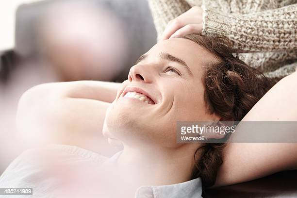 Portrait of happy young man stroked by his girlfriend