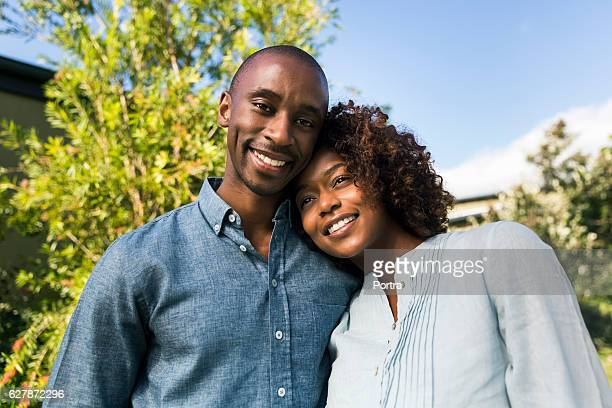Portrait of happy young man with woman in yard