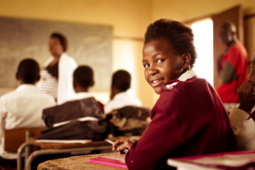 Portrait of happy Young South African girl in classroom 162957116