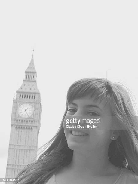 Portrait Of Happy Young Woman Against Big Ben In City