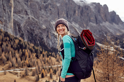Portrait of happy young woman hiking in the mountains - gettyimageskorea