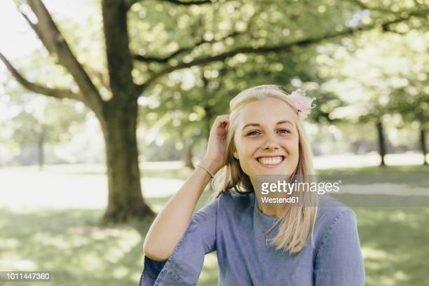 Portrait of happy young woman in a park