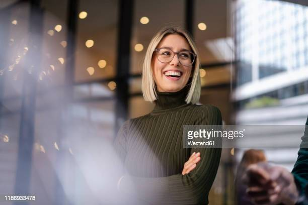 portrait of happy young woman in the city - differential focus stock pictures, royalty-free photos & images