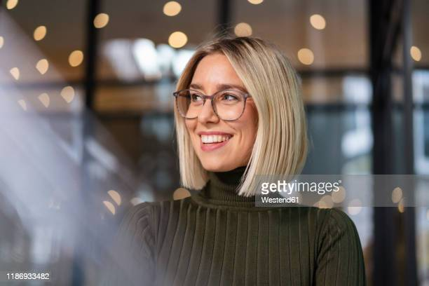 portrait of happy young woman in the city - green suit stock pictures, royalty-free photos & images