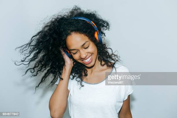 portrait of happy young woman listening music with headphones - gesturing stock pictures, royalty-free photos & images