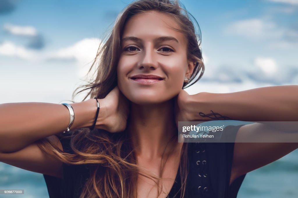 Portrait of happy young woman on beach, head and shoulders, Odessa, Odessa Oblast, Ukraine : ストックフォト
