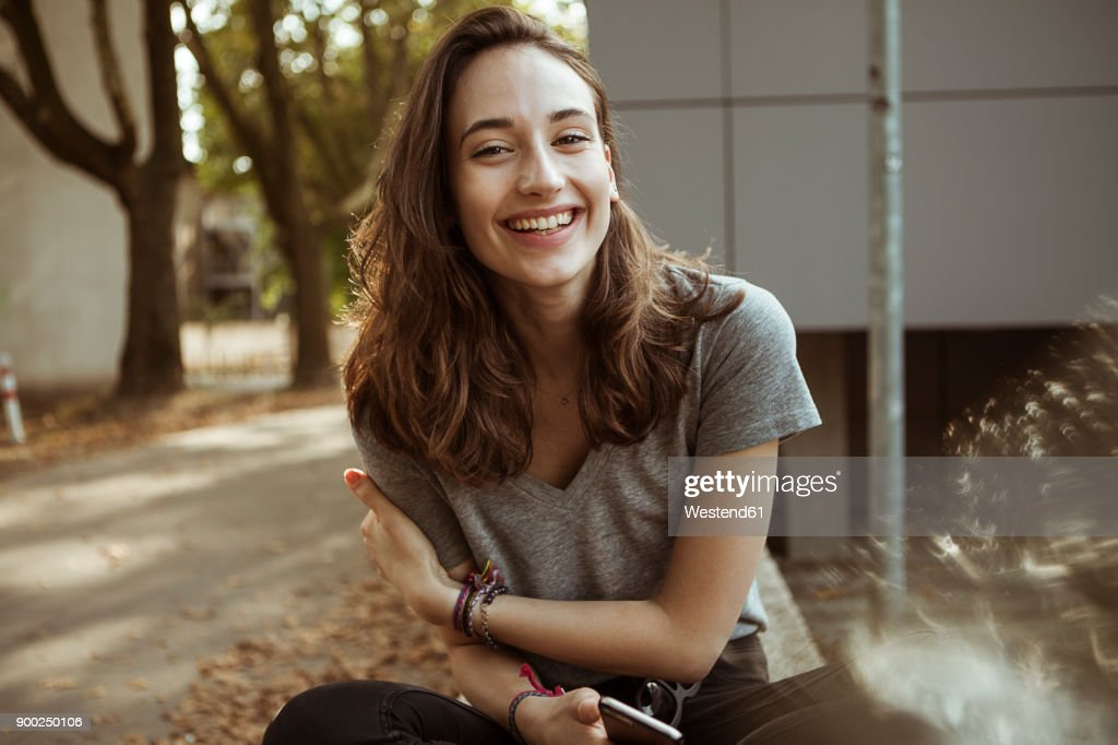 Portrait of happy young woman outdoors : Stock-Foto
