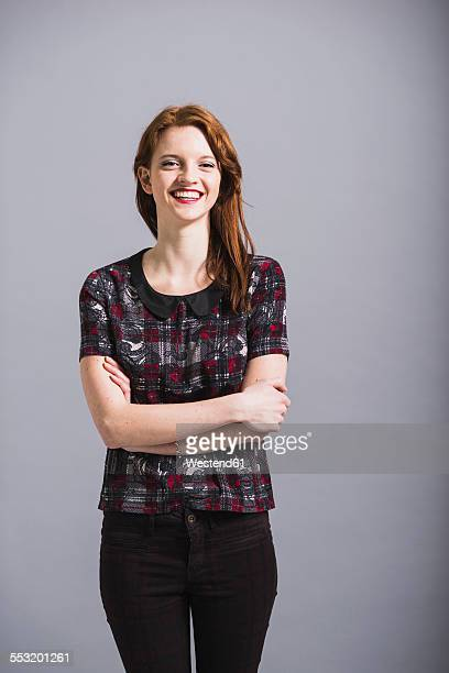 Portrait of happy young woman wearing pants and top